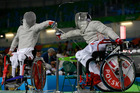 Poland's Adrian Castro competes with Yanke Feng. Photo / AP