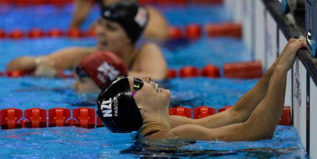 Sophie Pascoe reacts to winning a gold medal in the women's 100-meter backstroke S10 final. Photo / AP