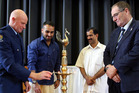 Community Constable Keith Butters (left) lights the Onam Festival lamp watched by Sreejith Sreekumar, Jacob Thomas and Whanganui MP Chester Borrows. Photos/Stuart Munro