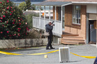 Rotorua police investigate the scene where a shot was fired on Taharangi St on Saturday.