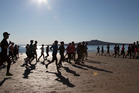 Runners make their way along Takapuna beach during the North Shore Marathon. Photo / Brett Phibbs