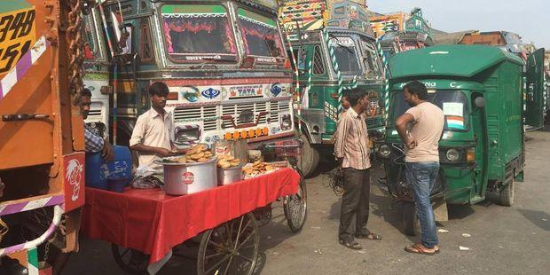 India blog: Trucks at the fruit market in Delhi. Photo/Juliet Rowan