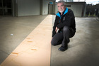 Print maker Graham Hall is putting together 20 metre wood cut print of the Whanganui River. Photo/ Bevan Conley
