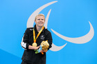 Cameron Leslie with his gold medal after his world-record effort in the SM4 150m individual medley at the Rio Paralympics. Photo/Photosport.nz