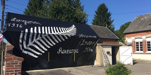A banner has been raised in the village of Longueval welcoming New Zealanders who have travelled to the region to mark the centenary of the Battle of the Somme. Photo / Kieran Campbell