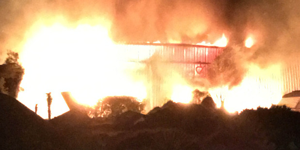 A building is engulfed in flames at Franz Josef in South Island. Photo / Supplied