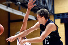 TIGHT TUSSLE: Action from NZ Breakers v Adelaide Bullets at ASB Arena. Photo: George Novak