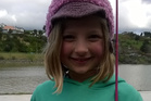 Six year old Ariele Ras who caught a rainbow trout in the Whanganui River.