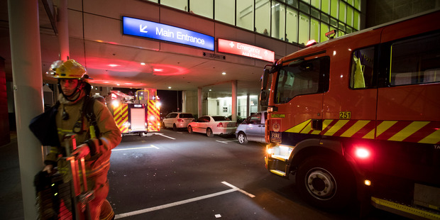 Fire crews attend an alarm at Auckland City Hospital tonight. Photo / Dean Purcell