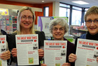 (From left) Tricia Duncan, Gillian Tasker, Jenny Shaw and Ann McNamara hold the latest Great War Times. PHOTO/ STUART MUNRO