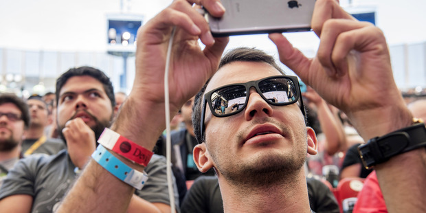 As video content increases, more of it is being viewed on mobile phones. Photo / Bloomberg