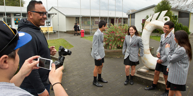 Loading Rotorua Intermediate Students (from left) Shaun Gifkins, 13, Jahzell Roberts, 12, Julius Smith, 13 and Mariah Pepper, 13, taking part in the Nga Pumanawa e Waru music video. PHOTO/STEPHEN PARKER