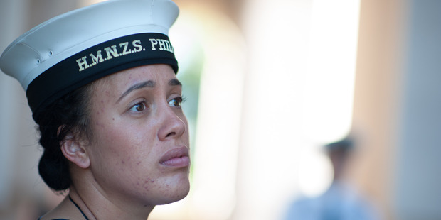 Aleisha MacGregor placed some uniquely Kiwi  items at the memorial on which her ancestor's name is inscribed. Photo / NZ Defence Force