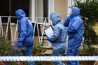 Forensic services police officers enter a home in the suburb of Miller in Sydney yesterday after a two year old girl was found dead at the home in Sydney's south west. Photo / AAP