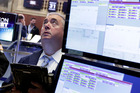 Trader Edward McCarthy works on the floor of the New York Stock Exchange. Photo / AP