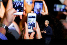 Apple CEO Tim Cook announces the new iPhone 7 during an event last week. Photo / AP