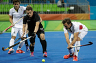 Shea McAleese (middle) showed the gritty resolve required during the Black Sticks' Olympics campaign. Photo / AP