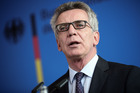 German Interior Minister Thomas de Maiziere delivers a statement in Berlin. Photo / AP