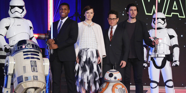 Director J.J. Abrams, third right, and actors, John Boyega, Daisy Ridley and Adam Driver. Photo / AP