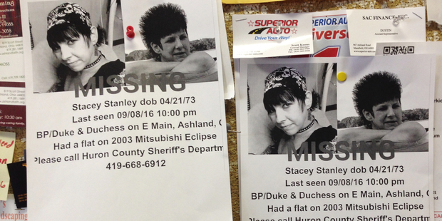 Missing person flyers for Stacey Stanley remain posted on a laundry mat bulletin board. Photo / AP