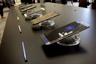 The Galaxy Note 7, foreground, is displayed in a New York launch. U.S. regulators have now issued an official recall of the phone. Photo / AP