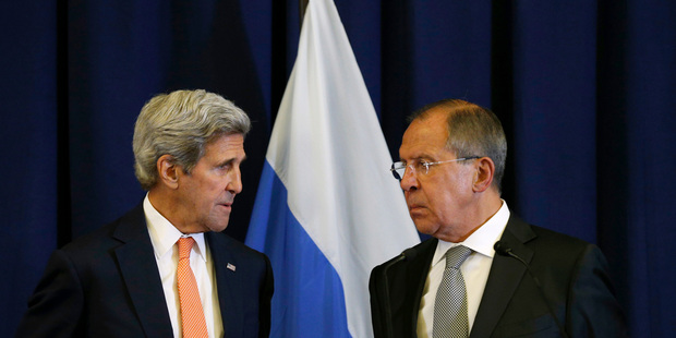 U.S. Secretary of State John Kerry, left, and Russian Foreign Minister Sergey Lavrov look toward one another during a press conference following their meeting in Geneva. Photo / AP