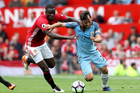 Manchester United's Eric Bailly, left, and Manchester City's David Silva battle for the ball during the English Premier League soccer match. Photo / AP.