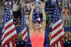 Angelique Kerber, of Germany, holds up the championship trophy after beating Karolina Pliskova, of the Czech Republic, in the women's singles final of the U.S. Open. Photo / AP.