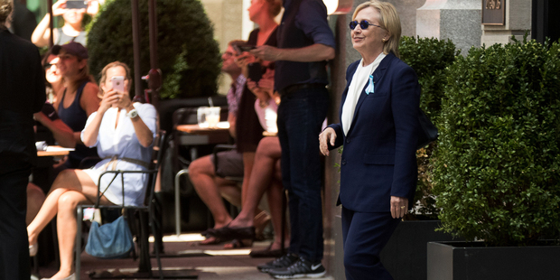 Is that the real Hillary Clinton exiting the building? Speculation has been rife that there was a body double standing in for the Democrat. Photo / AP