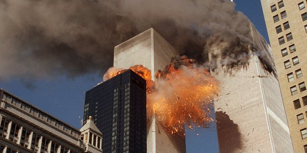 Smoke billows from one of the towers of the World Trade Center and flames and debris explode from the second tower. Photo / AP