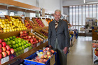 Greengrocer KC Loo in his Mt Eden Rd shop. Photo / Getty Images