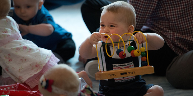 Prince George plays with the toys during a Plunket nurse and parents group visit at Government House in Wellington. Photo / Marty Melville