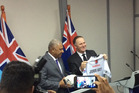 Prime Minister John Key and Fijian Prime Minister Frank Bainimarama exchange rugby themed gifts in Fiji. PHOTO/NZH
