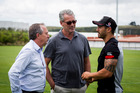 Warriors GM Jim Doyle and owner Eric Watson talk to Shaun Johnson during training. Photo / Dean Purcell
