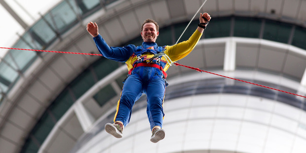 Dan Dalton takes the SkyJump off the Auckland Sky Tower. Photo / Jason Oxenham