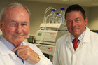 Sir Graeme Douglas with his son Jeff in a labs at Douglas Pharmaceuticals in Henderson. Photo / Greg Bowker