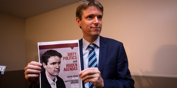Colin Craig holds a booklet he has produced during a press conformance held at the Spencer Hotel. Photo / Dean Purcell