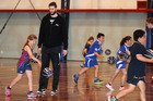 Alex Pledger mentors youngsters at a clinic in Hastings yesterday. Photo / Duncan Brown