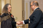 Dr Patricia Grace receives the Distinguished Companion of the New Zealand Order of Merit from Governor General Anand Satyanand at an investiture ceremony in 2007.