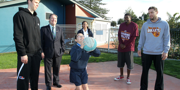 Tom Abercrombie of the Breakers (left), Napier mayor Bill Dalton,  Melika Samia of Napier Intermediate School and Jermaine Beal and Adam Gibson of the Brisbane Bullets watch Nastajia Gibbins shoot some hoops.