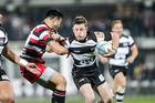 Magpies halfback Brad Weber tries to break a tackle. Photo / Paul Taylor