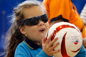 Charlotte Jamieson, from Onerahi School, gets ready to throw the ball.