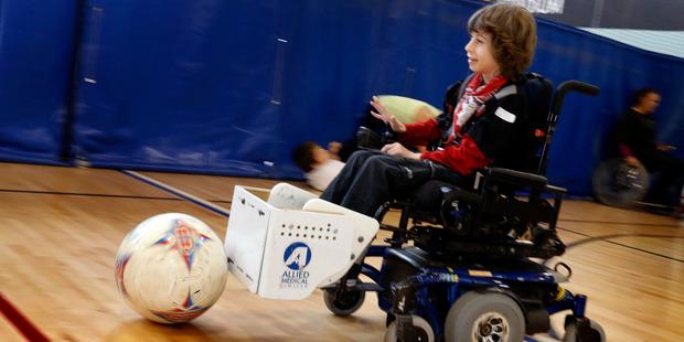 Max Thompson-Bailey from Horahora School takes part in the powerchair football. Photo / John Stone