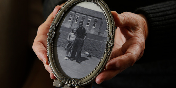 Beverley Lind holds one of only a few childhood photographs she has with her father Stanley Redway.