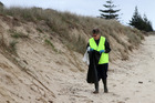 Lyn Silverthorne was having trouble filling her bag on Tokerau Beach.