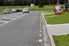 The No Parking lines that have appeared in Kaitaia's North Park Drive are seen by developer Wayne Brown as evidence of one rule for big business, another for the locals.