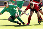 Central Mavericks player Martin Atkinson (green) competes for the ball. Photo / Tania Whyte