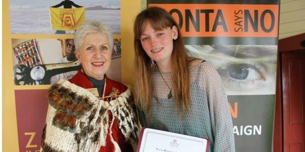Loren (right) receives her award. PHOTO/SUPPLIED