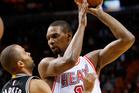 Miami Heat forward Chris Bosh looks for an opening past the San Antonio Spurs. Photo / AP