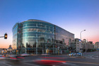 The Vodafone building, renamed VXV20, is noted for its sweeping, curved glass facade.